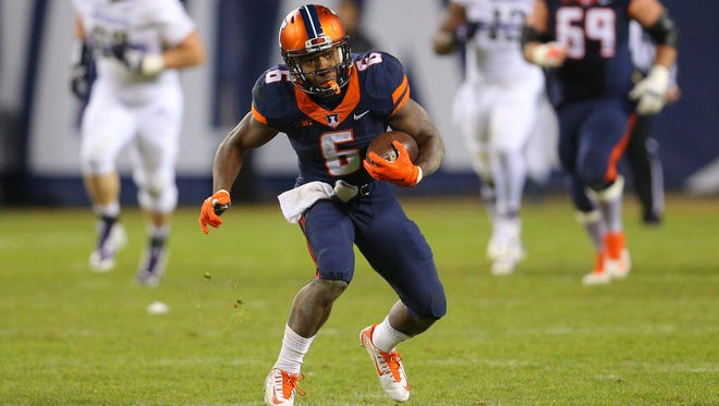 Nov 28, 2015; Chicago, IL, USA; Illinois Fighting Illini running back Josh Ferguson (6) runs with the ball during the second half against the Northwestern Wildcats at Soldier Field. Northwestern won 24-14. Mandatory Credit: Dennis Wierzbicki-USA TODAY Sports