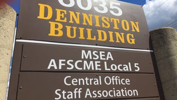 The Michigan State Employees Association is involved in a labor dispute with a union representing its office employees.