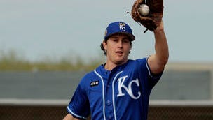 Kansas City Royals pitcher Seth Maness catches a ball during baseball spring training Tuesday, Feb. 14, 2017, in Surprise, Ariz. (AP Photo/Charlie Riedel)