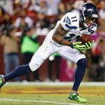 Percy Harvin catches the ball against the Washington Redskins on Oct. 6. Harvin was traded to the Jets on Friday by the Seahawks.