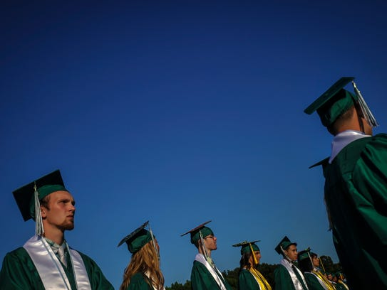 Graduates wait patiently at their seats during South