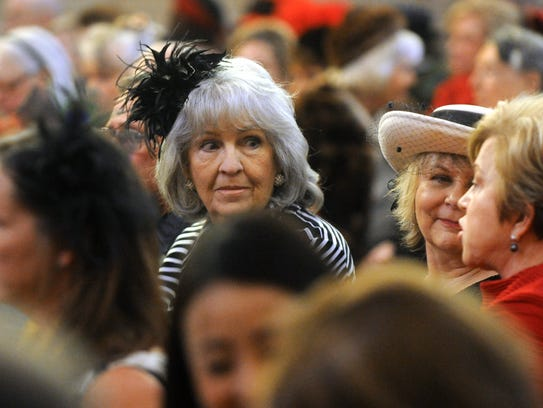 People wait for the beginning of a funeral service
