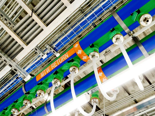 Cables, wiring and cooling pipes run overhead during
