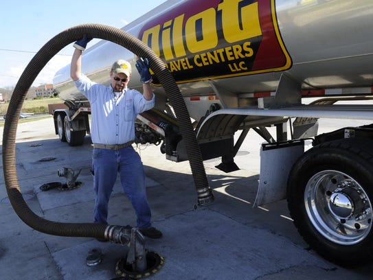 Fuel truck driver Dusty Fisher makes a delivery Thursday, Feb. 23, 2012 at the Strawberry Plains Pilot Travel Center.