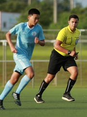 Michael Topasna, right, monitors play during a U15 Boys National Team training match at the Guam Football Association National Training Center in this file photo. Topasna has been selected by GFA to participate in the EAFF Referee Clinic 2018 and officiate matches during the EAFF U15 Boys Tournament in China.