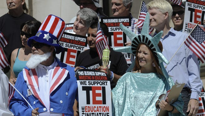 Supporters of the Nov. ballot question on creating a busines tax for education gathered in front of the old Wahoe County courthouse steps on July 3, 2014  to announce their plans for their campaingn.