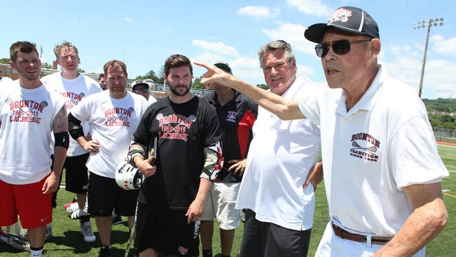 The Boonton boys lacrosse program held its annual alumni game, celebrating 50 years and honoring coach Dick Rizk (right), who addressed the players during a ceremony after the third quarter on Sunday at Boonton.