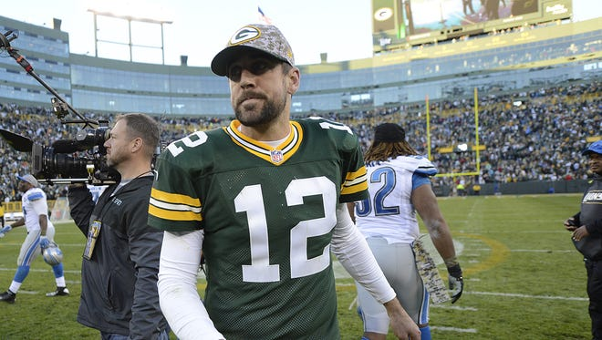 Green Bay Packers quarterback Aaron Rodgers walks off the field after the Packers were defeated by the Detroit Lions at Lambeau Field on Sunday.