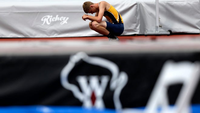 A competitor pauses for a moment while competing in the Division 1 high jump during the WIAA state track and field meet Friday at Veterans Memorial Sports Complex in La Crosse.