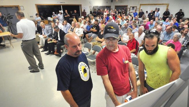 Residents look at plans for warehouse-distribution centers in Newberry Township Tuesday, July 26, 2016, during a meeting with township supervisors regarding the plans. The board unanimously approved the project, which includes construction of two large buildings. Bil Bowden photo