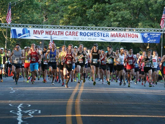 Runners take off at the starting gun for the full and half marathons at the MVP Health Care Rochester Half & Full Marathon Sunday, Sept. 20, 2015 in Rochester. The race course was changed this year and featured a route that ran through Maplewood Park, where the start was held.