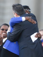 Lieutenant Gov. Jenean M. Hampton, left, hugged Gov. Matt Bevin during their swearing in ceremony at the Kentucky Capitol in 2015. Don't expect to see such a warm embrace between the two again.