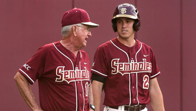 Mike Martin talks with Josh Delph (2) before an at bat as Virginia visits Florida State on Friday night for a match up of top 5 teams.