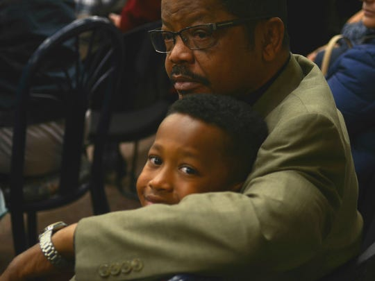 In this 2016 Darryl Feemster, is photographed with his 8-year-old grandson, Marcus