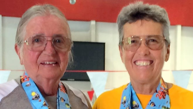 Yenny van Dinter, left, and Pamela Gulbrandson brought home a total of eight medals from the swimming competition at the NM Senior Olympics in Albuquerque.