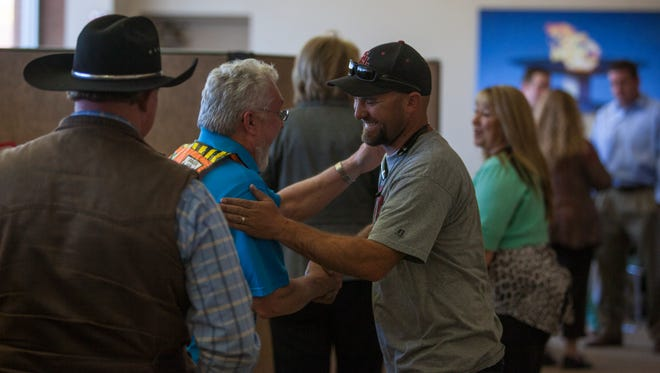 Steve Ahlgreen, marketing and operations director of the Utah Summer Games, shares a laugh with a friend during his retirement party, Wednesday, March 16, 2016.