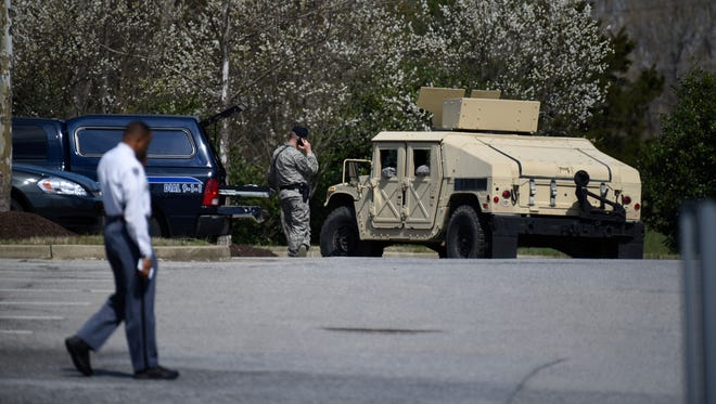 Air Force Security officers and Prince George's County, Md. Police, are seen near the location where a military aircraft crashed, April 5, 2017, in Clinton, Md.