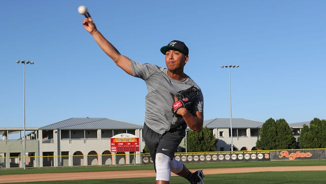Former Palm Desert High School pitcher Jeremiah Estrada throws some warm-up pitches, February 5, 2018.  Estrada was drafted by the Chicago Cubs.