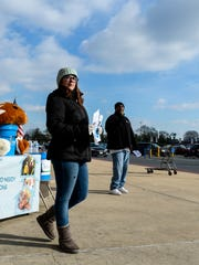Nicki Heil, fundraising assistant for We Agape You, and Randolph Simmons, president of We Agape You, work to raise money for homeless and unemployed veterans outside of Wal-Mart in Lebanon on Thursday, Jan. 21, 2016.  WAY's program concentrates on employment training, housing assistance and automobile purchase assistance.
