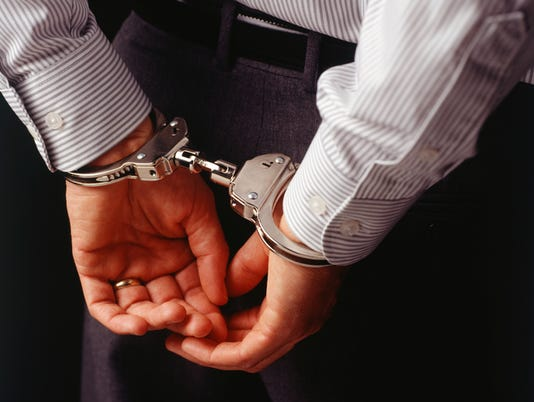 Man in handcuffs, rear view, mid section, (Close-up)  #filephoto