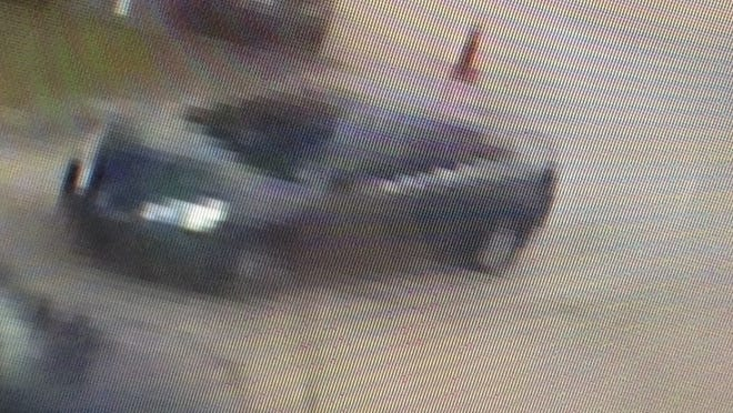This surveillance photo shows a dark Pontiac G6 driven by a man suspected of trying to lure young girls to his vehicle.