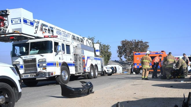Firefighters and paramedics treat injured motorcyclist
