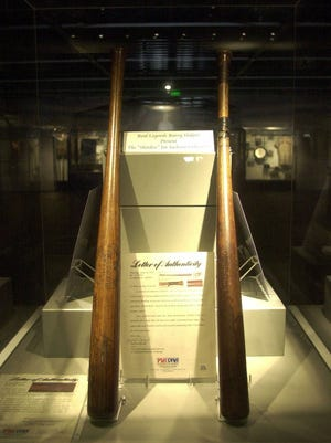 "The Black Betsy, right, and a second bat of ""Shoeless"" Joe Jackson, are on display at the San Diego Hall of Champions, in this July 18, 2001 photo. The Internet auction of Jackson's prized bat neared its end Tuesday August 7, 2001 with just one bidder, at the minimum price of $500,000. (AP Photo/Lenny Ignelzi)"
