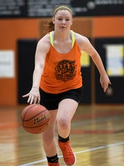 Hannah McLucas, practices early Monday, Nov. 21, with