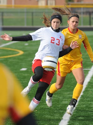 Zane Trace's Rachel Hutton (23) controls the ball against Bishop Fenwick in a Div. III regional final game at Bellbrook High School in on Nov. 3, 2012.