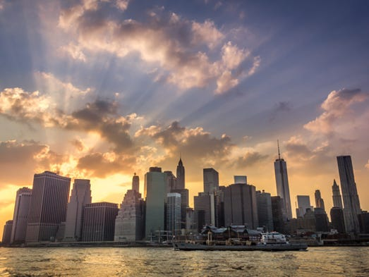 """USA TODAY asked readers to share their best sunset photos. Here are some of our editors' favorites, to submit your own please go to usatoday.com/yourtake/<br /> <br /> """"I was waiting for the beams of light for the 9/11 memorial to be turned on when this amazing sunset appeared!"""""""