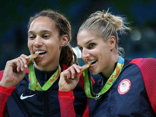 Brittney Griner (left) and Elena Delle Donne bite their