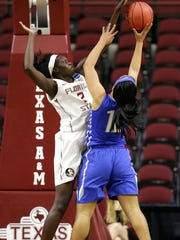 Florida State's Adut Bulgak (2) blocks the shot of MTSU's  Brea Edwards (12) in the NCAA Tournament first round in College Station, Texas, on March 19, 2016. Florida State won 72-55.