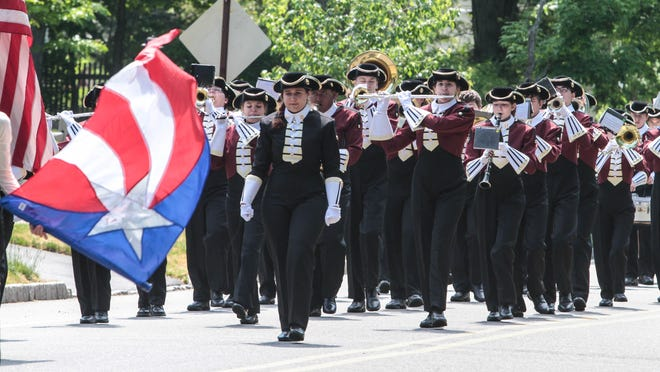 The Morristown High School marching band perform during the annual Memorial Day Parade.