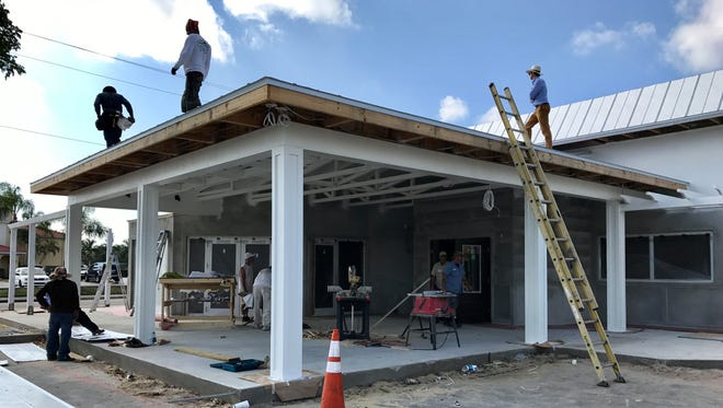 Workers are finishing up renovations for the forthcoming Point 57 restaurant in Cape Coral. It's one of five new restaurants opening on a 0.7-mile stretch of Del Prado Boulevard.