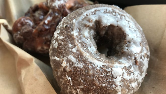 A chocolate cake doughnut and an apple fritter from Abbe's Donut Nook in south Fort Myers.
