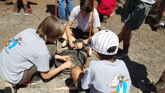 Scouts from Troop 787 in Thousand Oaks assemble a fire using wood chopped themselves for the string burning competition.