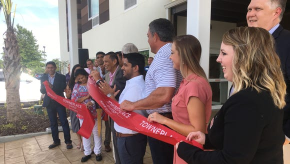 City and hotel officials cheer the opening of Towneplace