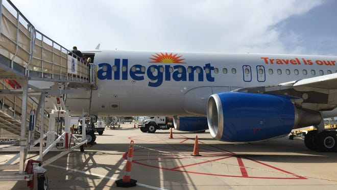 Passengers board an Allegiant Air flight at Punta Gorda Airport.