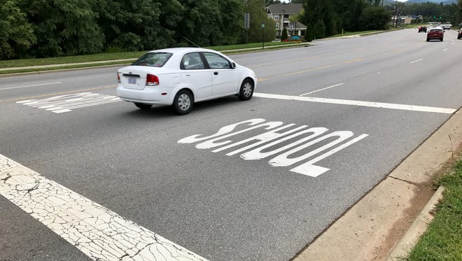 A reader asks if the DOT or the Buncombe County Schools could add flashing lights in the school zone on Long Shoals Road.