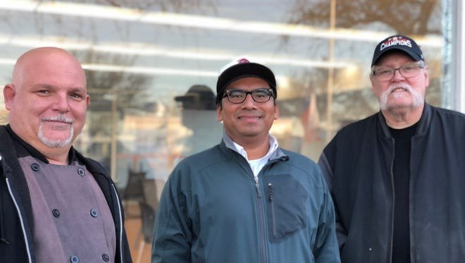 Kye Brown of Kyes Cuisines, Job Pozos-Avila of Chavelo's Ceviche and Dave Sample of Sample This Barbecue and Catering stand outside the seating area of North Block Food Pod, Salem's new food pod.