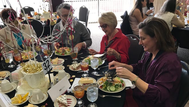 Susan Robinson, middle, and Kathy Robinson enjoy conversation and food during McMurry University's 2018 Women's Leadership Luncheon on Thursday. The event, held on International Women's Day, featured keynote speaker Dian Graves Stai, who is the founder and chair of the Dian Graves Owen Foundation.