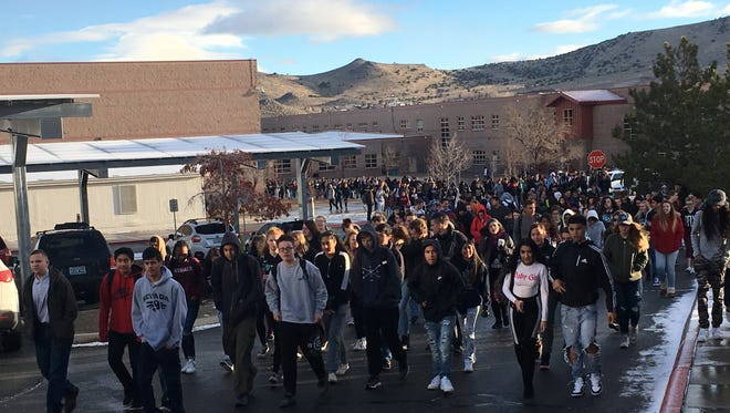 Students at North Valleys High School participate in a national walkout Wednesday, March 14, 2018 to urge lawmakers to take action on gun control.