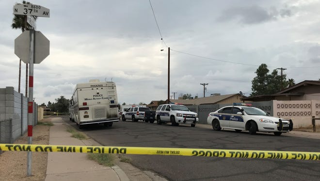 Police tape blocks off the street where officers were involved in a shooting June 16, 2018, near 37th and Ruth avenues in Phoenix.
