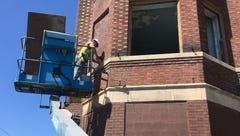 On deadline day, workers begin boarding up Ilitch buildings on Cass