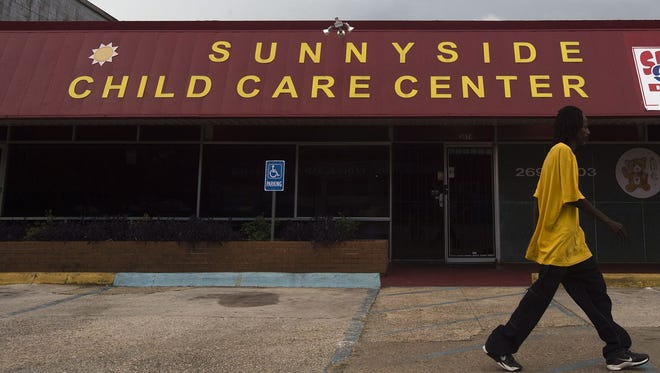 A man walks past Sunny Side Child Care Center in this file photo. On June 23, 86 children, ages ranging from 2 to 10, left Sunny Side Child Care Center at around 3 p.m. June 23 and were rushed to Baptist South, Baptist East and Jackson Hospital suffering from severe dehydration, vomiting,