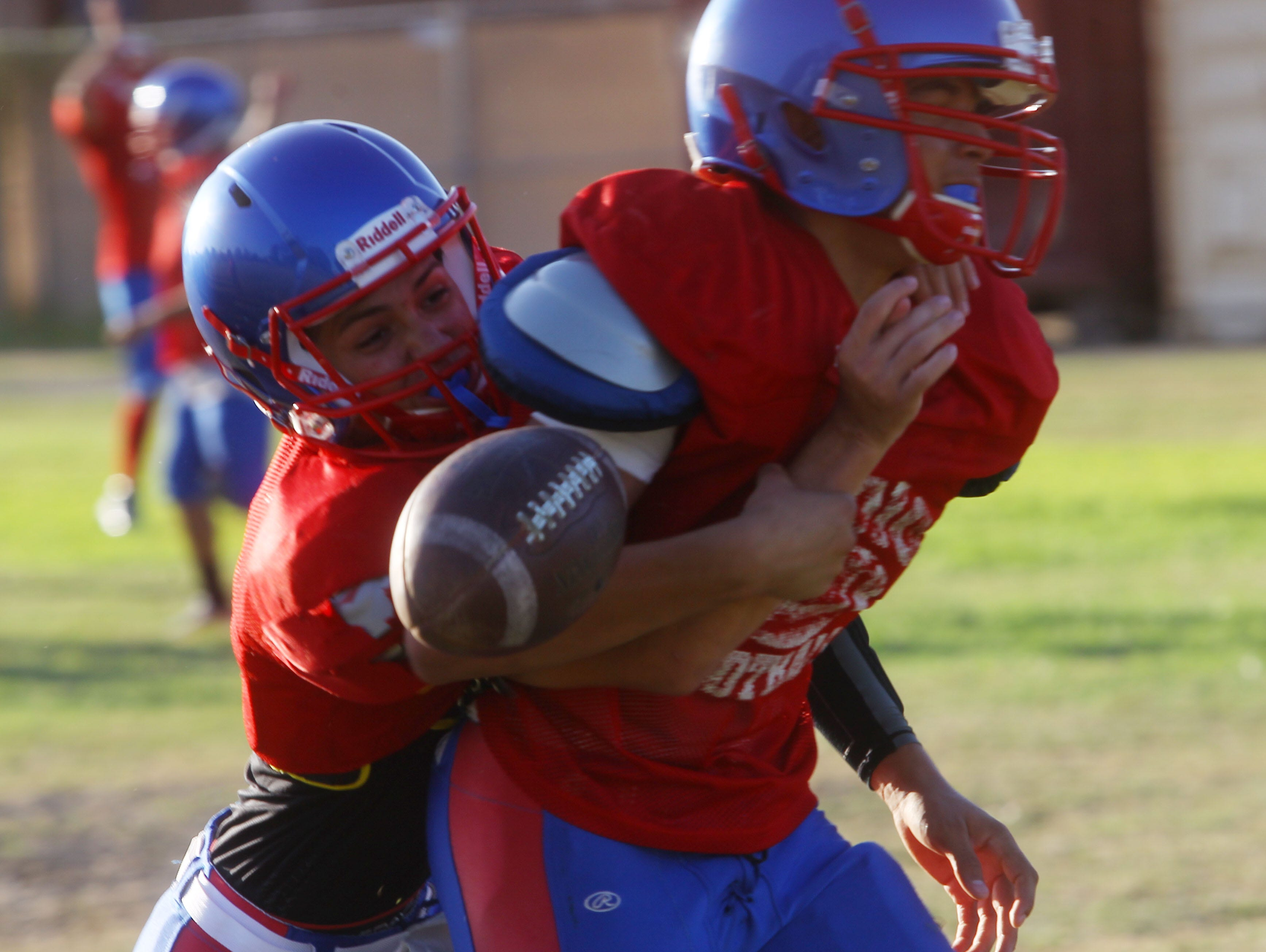 FILE - Indio High School varsity football team practices in August in preparation for their upcoming 2016-2017 season.
