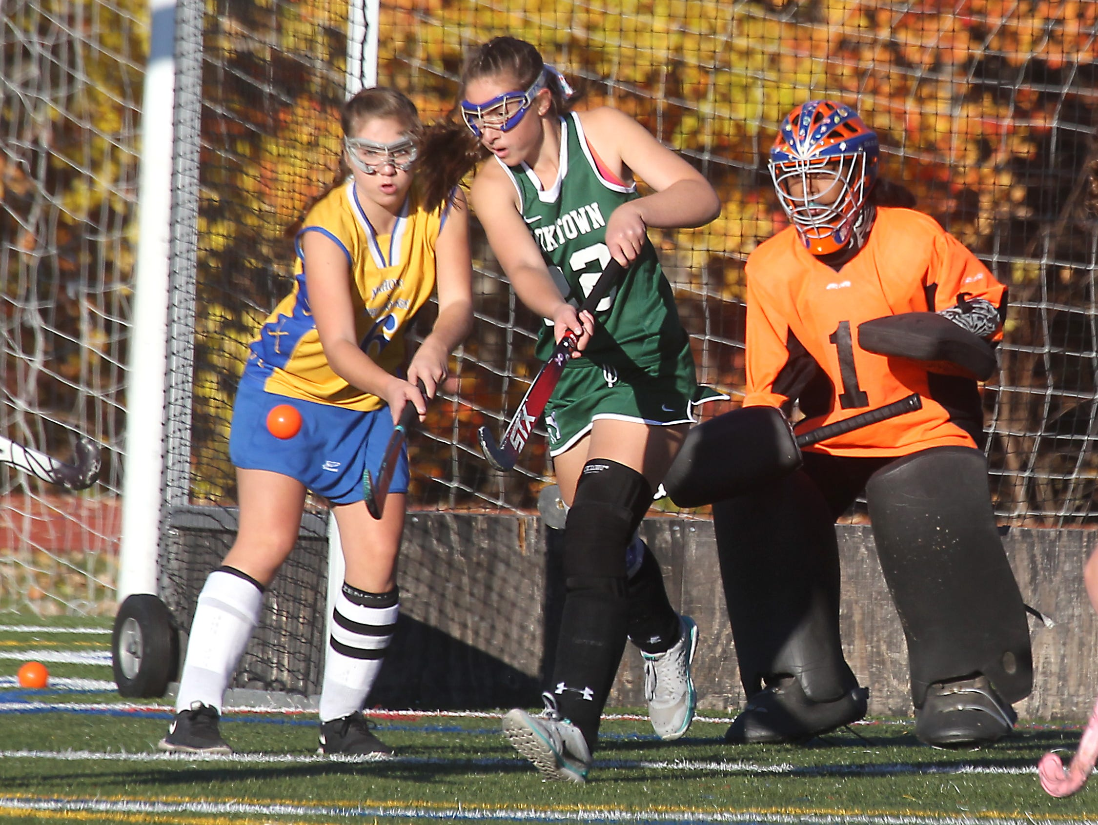 Yorktown's Julia Wurzel (22) clears the ball away from Mahopac's Gianna DeCola during their Class A opening round playoff game at Mahopac Oct. 26, 2015. At right is Yorktown goalie Olivia Sanchez. Mahopac won 3-2.