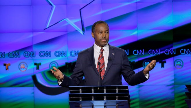 Retired neurosurgeon Ben Carson, a Republican candidate for president, speaks during a Republican debate at the University of Houston.