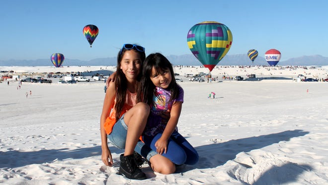 Antonia and Bela Olmeda, Las Cruces residents, visit White Sands National Monument with their mom during the 25th White Sands Balloon Invitational.