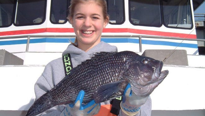 Chelsey Bogan, age 14 caught this 4lb., 8oz., giant sea bass on a long range wreck trip on the 125' Jamaica on Monday Feb 14, 2005.